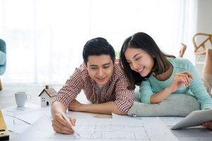 Couple looking at blueprints