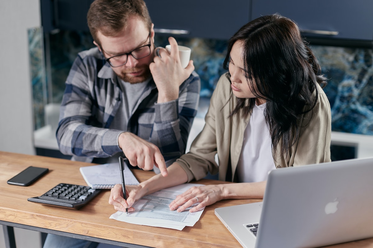 Couple gathering repair cost estimates in preparation to sell their home as-is