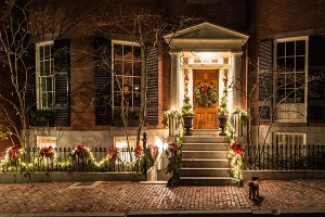 Front door of house with holiday lights