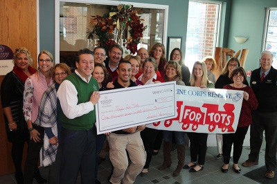 Verani and Broker's Title present Toys for Tots with their donation