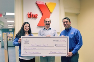 presenting donation to YMCA