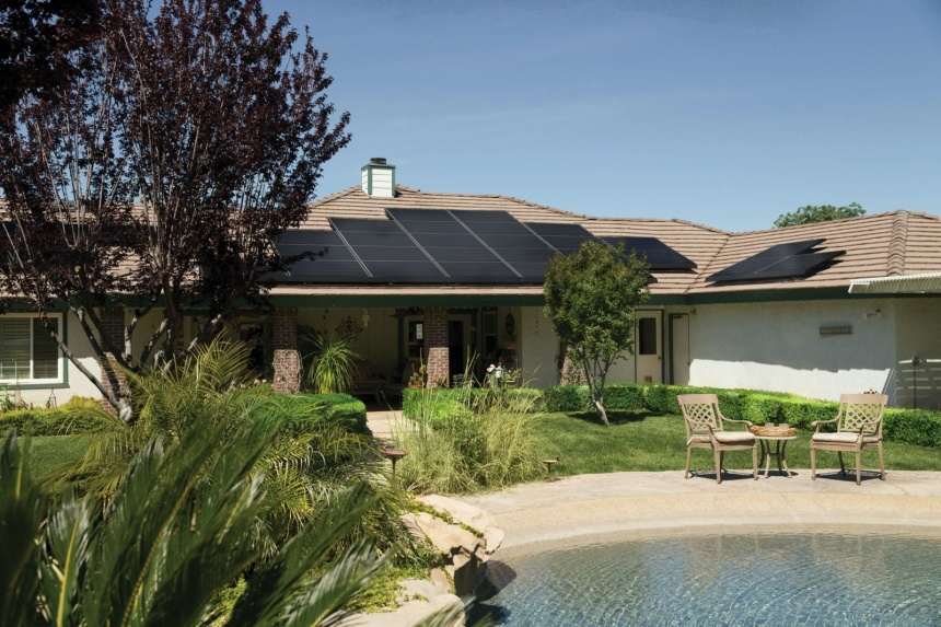 house backyard with pool showing solar panels on home