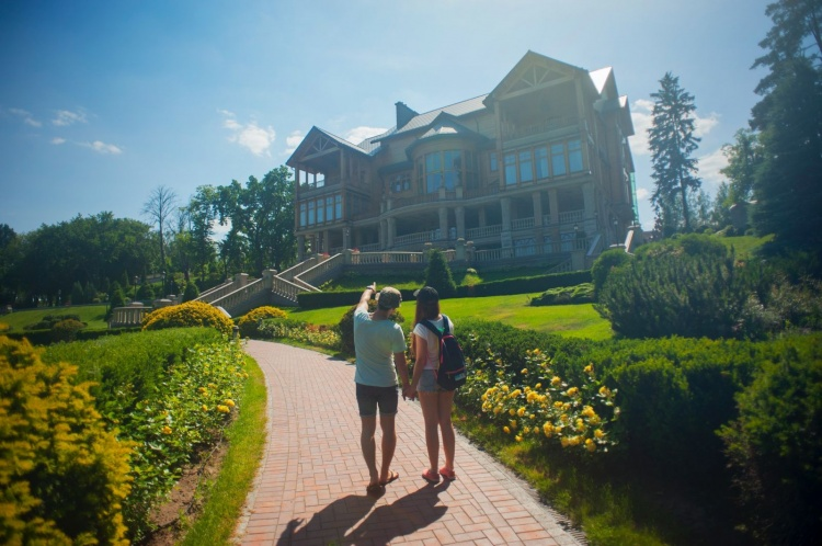 couple checking out new house from the outside