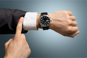 pointing at wristwatch