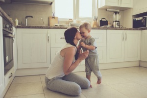 mom with toddler in kitchen