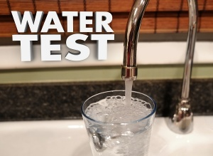 water coming out of faucet with words water test