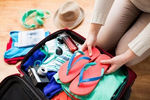 putting flip flops in suitcase