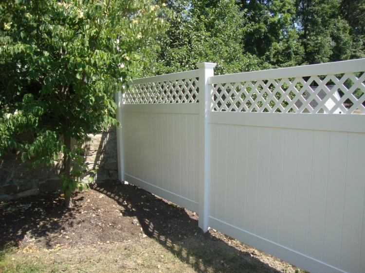 a vinyl fence can be a good way to block unsightly views with creative landscaping