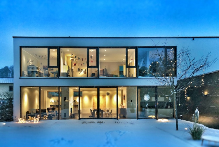 house with glass walls ready for winter