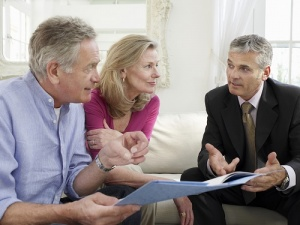 mature couple with realtor