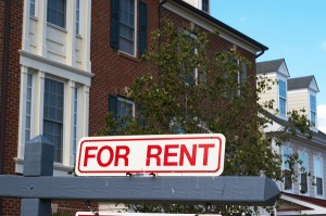 For rent sign in front of apartment